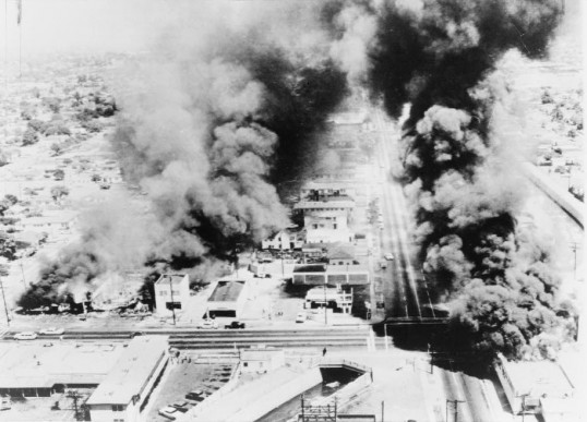 Buildings in the Watts section of Los Angeles burn in August of 1965.